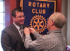 Jason Walker receives his Rotary Pin From Jim Evers